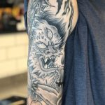 Healed tattoo of a Japanese Oni Demon with spiked bat, on an upper arm. Tattooed at Cult Classic by Antony Dickinson