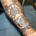 fine line black and grey rose and pocket watch tattoo on man's forearm tattooed in romford essex at cult classic tattoo