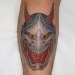 Hannya, demon mask on the back of a man's calf, tattooed by Aaron Hewitt