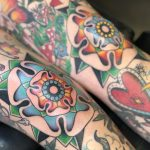 bright and bold tudor rose knee tattoos on woman with full leg sleeves tattooed in romford, essex at cult classic tattoo