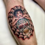 Traditional pin up girl, spiderweb and skull by Antony Dickinson. Tattooed at Cult Classic Tattoo in Romford Essex