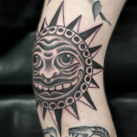 Black work traditional old school style sun tattoo on a knee Tattooed by Ant Dickinson, Northernbuilt at Cult Classic Tattoo in Romford, Essex, just outside of London