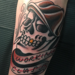 traditional skull and flat cap, old school tattoo with banner and lettering that read working class tattooed in romford, essex at cult classic tattoo