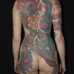 Full Japanese Back Piece by Aaron Hewitt on A woman. It is large Japanese dragon with Peonies. Tattooed by Aaron Hewitt at Cult Classic Tattoo in Romford, Essex just outside of London