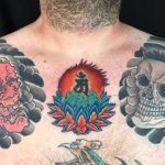 Bright, colourful lotus and bonji japanese style tattoo with skull and hannya chest plates tattooed by Aaron Hewitt at Cult Classic Tattoo in Romford, Essex just outside of London