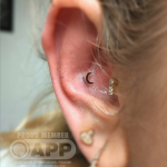 14 karat gold crescent moon piercing by Mala Piercing in Romford, 15 minutes from London