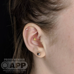 Curated ear with Daith piercing by Mala Piercing