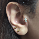 Curated ear with Swarovski crystals by Joe Espin of Mala Piercing