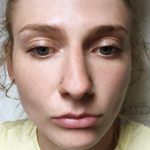 Woman with two nose piercings, both with 14 karat gold, pierced by Joe Espin of Mala Piercing in Romford, Essex just outside of London