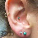 Luxury piercing by Joe Espin, APP affiliated piercer at Cult Classic Tattoo in Romford, Essex just outside of London. Curated ear.