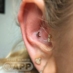 Curated ear with luxury fold crescent moon jewellery Luxury piercing by Joe Espin, APP affiliated piercer at Cult Classic Tattoo in Romford, Essex just outside of London