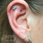 Curated ear with luxury jewellery Luxury piercing by Joe Espin, APP affiliated piercer at Cult Classic Tattoo in Romford, Essex just outside of London