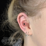 Curated ear Luxury piercing by Joe Espin, APP affiliated piercer at Cult Classic Tattoo in Romford, Essex just outside of London