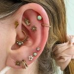 A curated ear. Piercing and designed by Joe Espin and Jay Bevins of Mala Piercing in Romford Essex