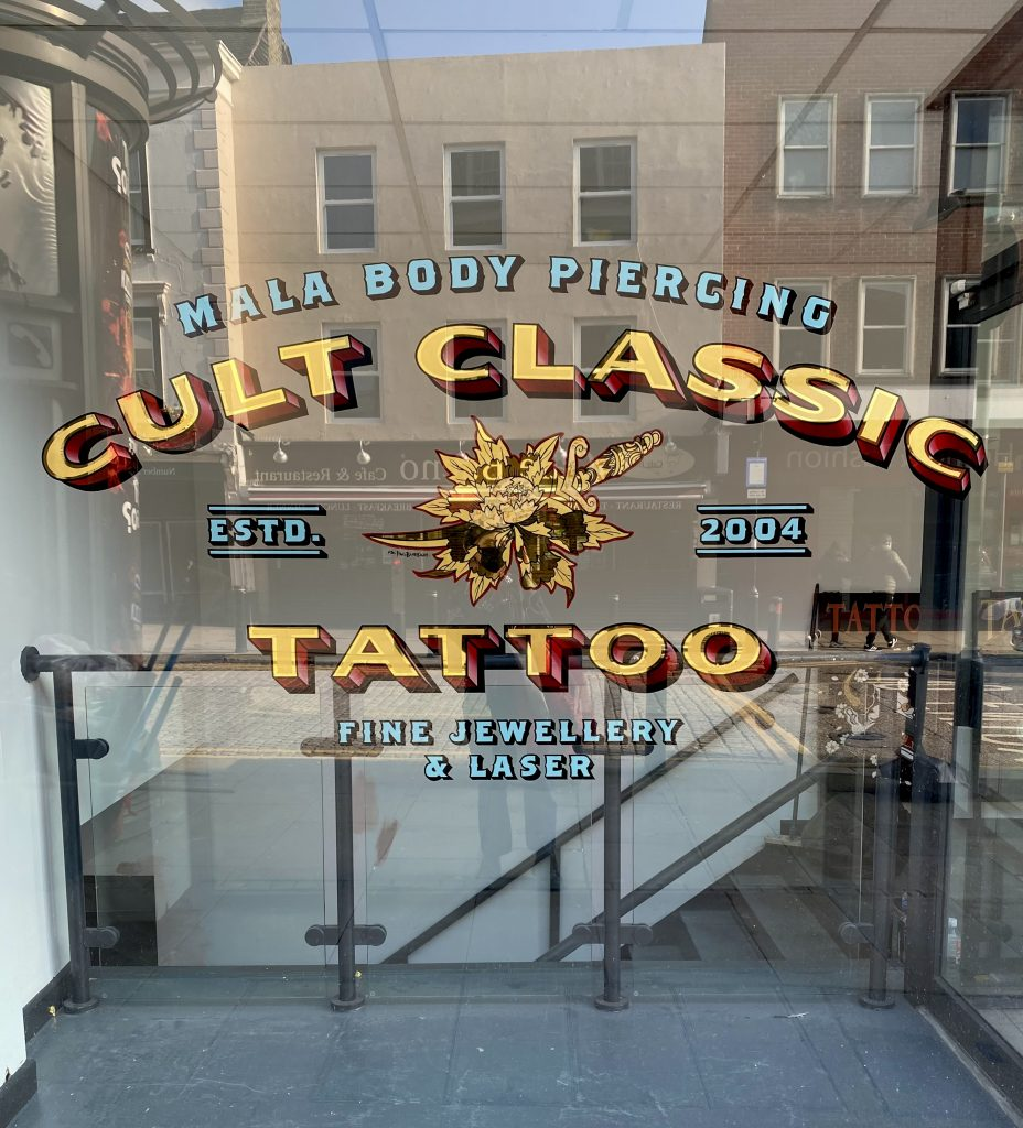 Cult Classic Tattoo's window, hand gilded by Paul Banks. Cult Classic Tattoo specialise in custom tattooing in Romford, Essex. 15 minutes from London
