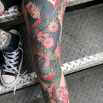 A woman's leg, tattooed with a large japanese snake with a woman's head. A nure-onna, which is a japanese mythological creature. Tattooed by Aaron Hewitt at Cult Classic Tattoo in Romford. Just outside of London