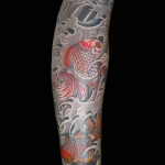 Japanese goldfish and water background. Part of a full sleeve tattooed by Aaron Hewitt at Cult Classic Tattoo in Romford, Essex. 15 minutes from London Liverpool Street.
