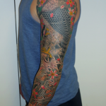 Traditional Japanese Hawk and Koi full sleeve. Covering laser tattoo removal by Joe Espin and tattooed by Aaron Hewitt, both at Cult Classic Tattoo in Romford, Essex. 15 minutes from London Liverpool Street.
